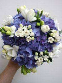 Hydrangeas (the blue flowers) are in season in Sept. This makes a pretty bouquet or centerpiece.