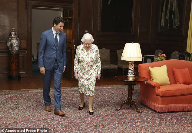 Britain's Queen Elizabeth II walks with Canadian Prime Minister, Justin Trudeau, during an audience at the Palace of Holyroodhouse in Edinburgh, Scotland, Wednesday July 5, 2017. Trudeau leaves Thursday for Hamburg and the G20 meetings. (Andrew Milligan/Pool Photo via AP)