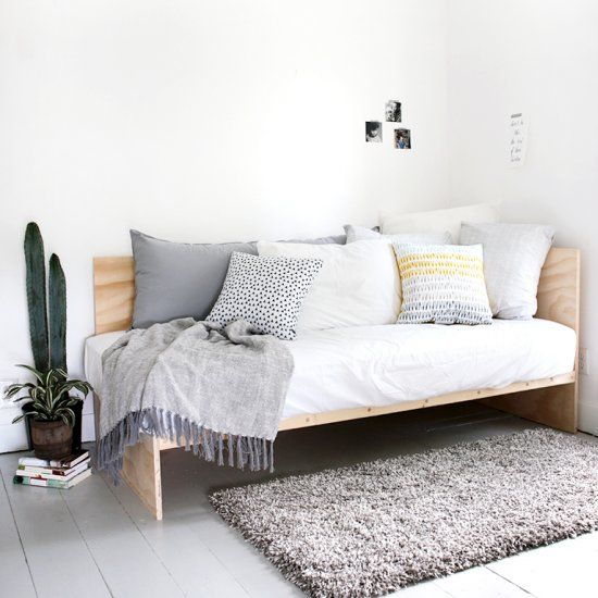 This DIY plywood daybed is a great place for relaxing and hanging out during the day - and a comfy spot to sleep at night!