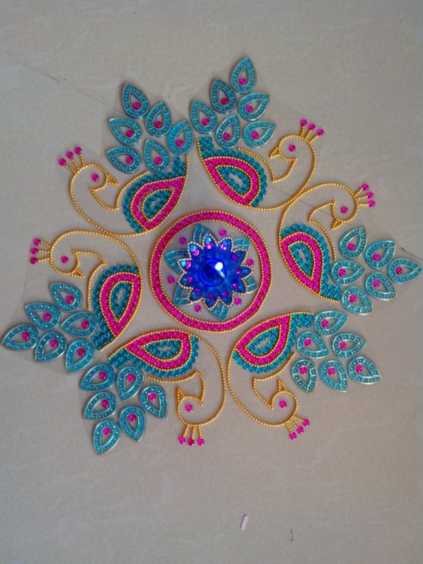 kundan peacock rangoli with diya