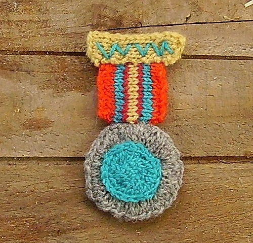 Knitted war medal brooch  must create a crochet version!