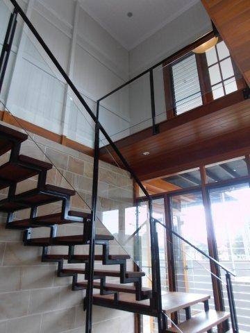Steel framed stairs with timber treads & glass balustrade.  www.empiredesigns.com.au
