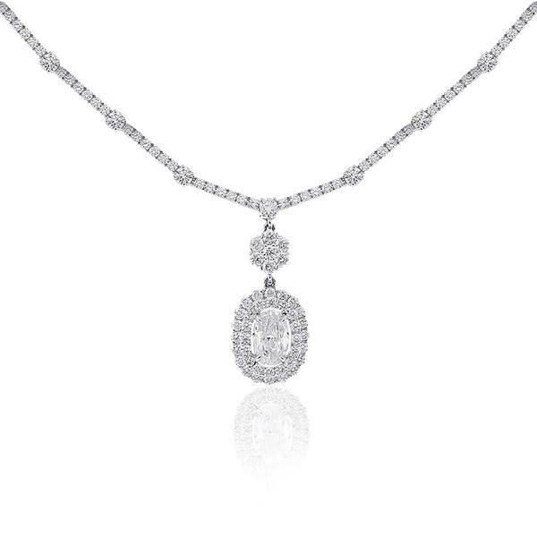 Aura Duet diamond necklace featuring a stunning 1.01ct oval diamond as its centrepiece. This diamond is independently certified by GIA. The surrounding diamond cluster and full circle diamond collier complete this stunning evening piece and add over 5carats of diamonds. This necklet is crafted in luxurious platinum.