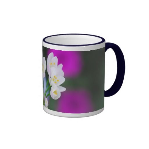 An ornamental onion, blooming summer flowers. #mug An ornamental onion, this blooming flower is an ornamental plant in a summery garden, the main colors of the picture are white, pink and blue. A mug for flower lovers. Photographed by Katho Menden .