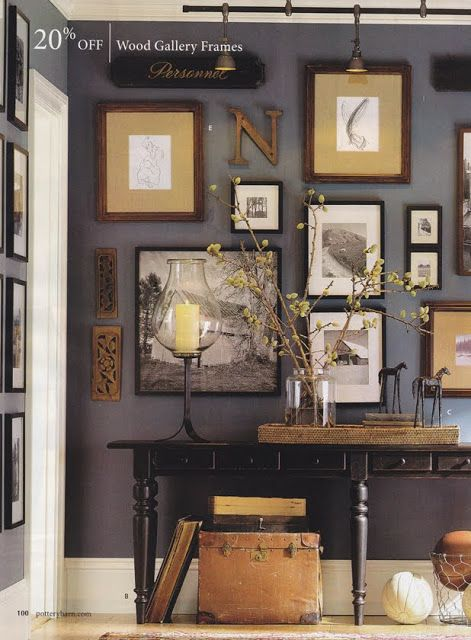 Living room collage wall - Dark gray walls with brown, white, and black accents