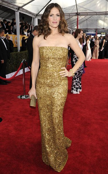 Jennifer Garner-  I'm still waiting to hear who designed Garner's stunning gold metallic gown (Shame on you, fashion publicist, whoever you are!). But there's no question that, although Garner attended the SAG Awards in the role of supporting wife to Argo director Ben Affleck, she was one of the night's best dressed leading ladies. Update: Garner's gown is from Oscar de la Renta's Pre-fall 2012 collection. A