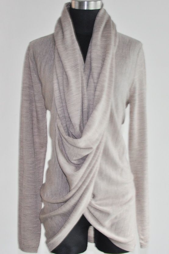 This convertible draped neck cardigan sweater features a long shawl collar. Converts into draped neck top with collar twists at front and buttons behind neck. Throw this selection over simple tees and tanks, even body conscious dresses to carry you from day to night. Rolled edge at placket. Long sleeves.  Can be purchased from Girlfriend's Material.