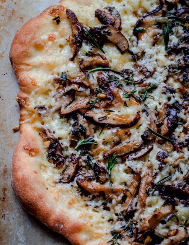 Mushroom Pizza with Herbs, Aged Havarti, and Truffle Oil - this pizza recipe is a crowd favorite!