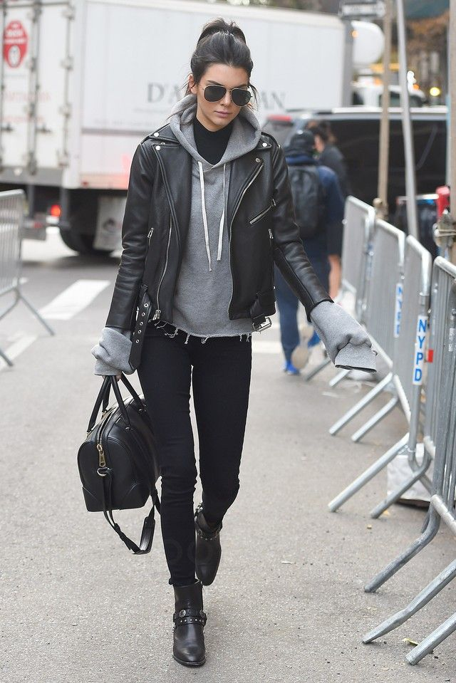 Kendall Jenner wearing L'agence Chantal Low-Rise Skinny Jeans, Saint Laurent Wyatt 40 Concho Harness Ankle Boots, Saint Laurent Classic 11 Aviator Sunglasses, Saint Laurent Motorcycle Jacket, Givenchy Lucrezia Bag, Forward by Elyse Walker Unravel Oversized Cashmere Hoodie