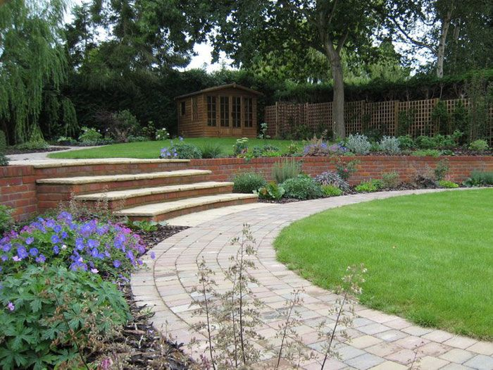 Curving paths run beside a large lawn steps rise to for Pictures of garden steps designs