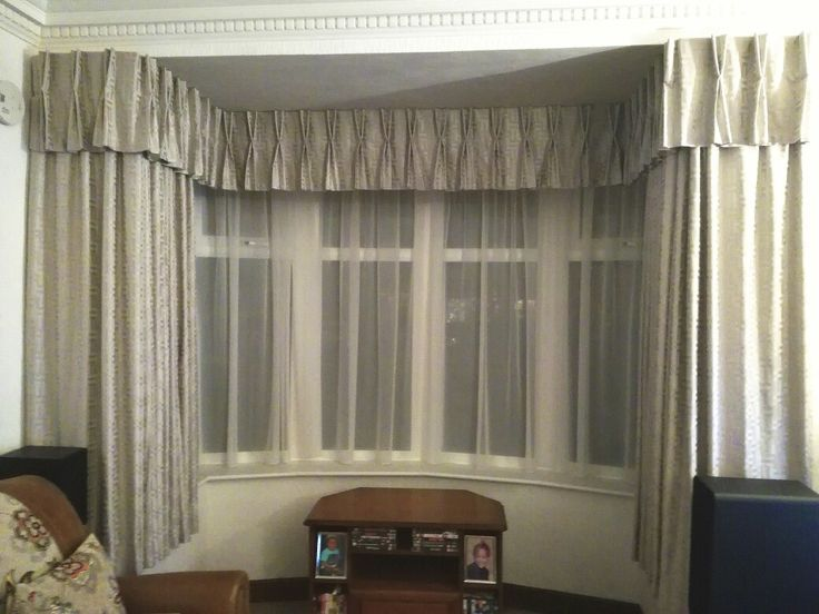 Pencil pleat curtains in a neutral Villa nova valetta fabric. They dress a large window with elegance #villanovafabric #pencilpleatcurtains #windowdressing