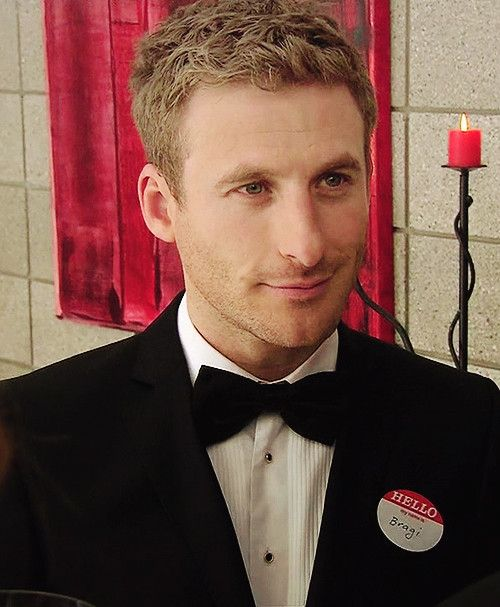 "Dean O'Gorman cleans up good.  His namebadge says ""Bragi"" his character in the NZ television show ""Almighty Johnsons."""