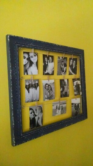 DIY clothes pin frame. Made with a $3 Goodwill frame, spray paint, sand paper, frame eyelets, mini clothes pins and hemp string.