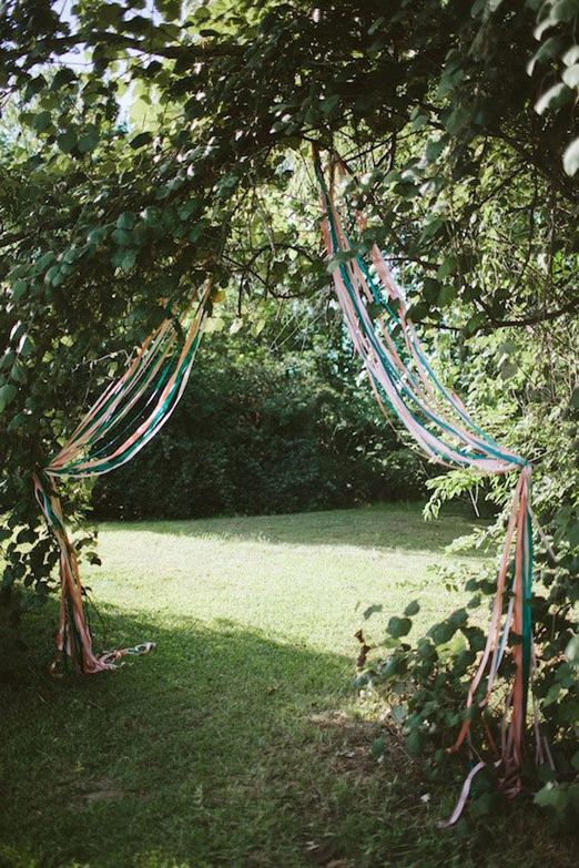 A pretty ribboned entrance way for an outdoor wedding ceremony
