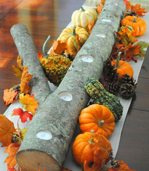20 Effortlessly Beautiful DIY Fall Centerpieces- Autumn Log Centerpiece- Blogger Jenna Burger used a log from a fallen tree in her neighborhood as the base of this rustic centerpiece, then drilled holes along the center for tea lights. Get more craft inspiration this season at redbookmag.com.
