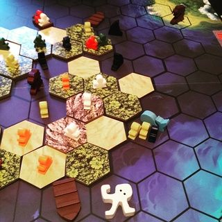 A really great game where the players try to escape the sinking island occasionally helping each other but mainly feeding each others explorers to sharks and sea monsters!