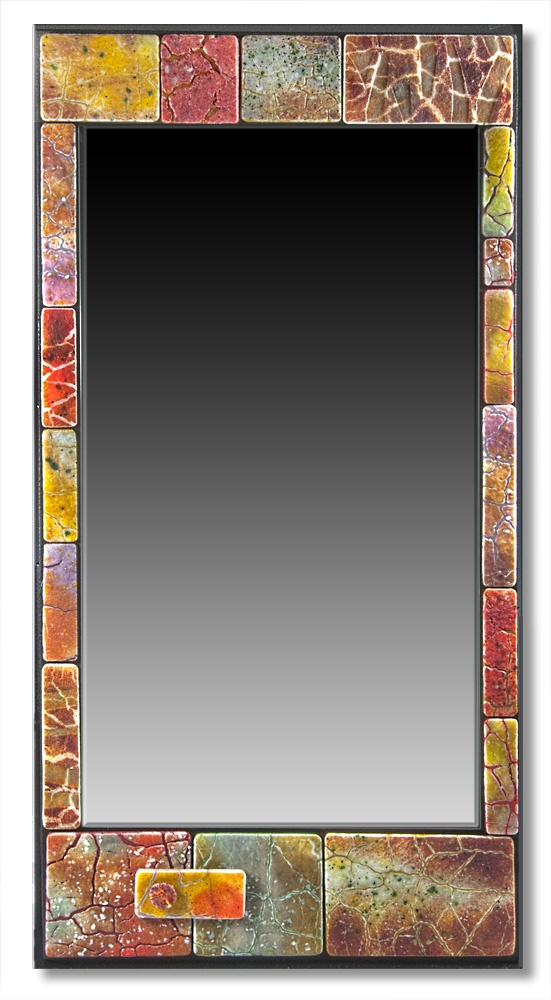 Mirror surrounded by mosaic pieces created with fused glass tiles that I made using frits and powders fused onto sheet glass. by Nancy Cann   www.cellarart.com.