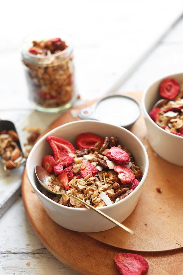 Easy, 30-minute granola infused with coconut, naturally sweetened with maple syrup, and mixed with crunchy freeze-dried strawberries!