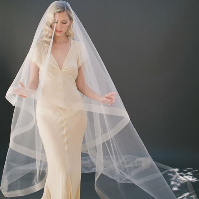 "This elegant drop veil is bound to compliment nearly any wedding gown. Our lovely is lined with 2"" horsehair on the edge of soft Bridal Illusion Tulle. Model is wearing our cathedral length option in champagne tulle. It's a Veiled Beauty wedding veil favorite [style 1203-2]! Only at www.veiledbeauty.com.  #bride #bridalveil #horsehair #vegan #veganveil #2015 #2016 #weddinginspo #weddinginspiration #elegant #elegante #elegance #champagne #champagnewedding #dropveil #cathedral #simple…"