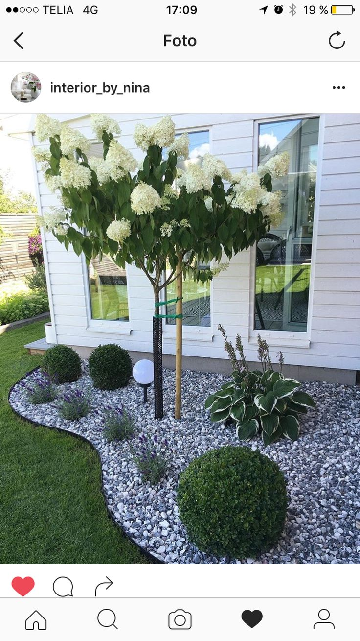 Use gray stones in the front yard flower beds as seen in the photo above.