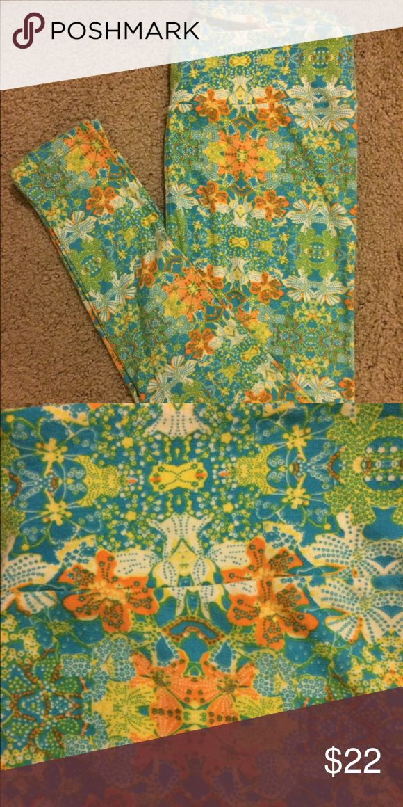 Lularoe TC leggings. Lularoe TC leggings. Never worn. Aqua, lime green, yellow, and orange. LuLaRoe Pants Leggings