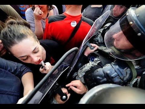 Woman Uses Police Shield to Apply Lipstick in Macedonia protest