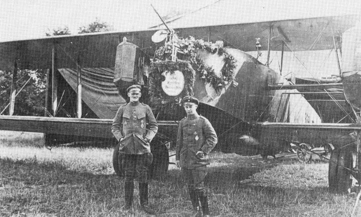 Oberleutnant Freiherr Marschall von Bieberstein, Staffelfuehrer of Bosta II in Bogohl I, with his pilot, Leutnant Nieber, in front of their Friedrichshafen G.IIIa 836/18. One of the most resolute bomber commanders, von Bieberstein, for whom the heaviest anti-aircraft fire held no terrors, rejoiced in the nickname of 'Emir - enemy of the infidels'. The decorative laurel wreath on the nose of his aircraft is in celebration of his return from his 250th operational flight.
