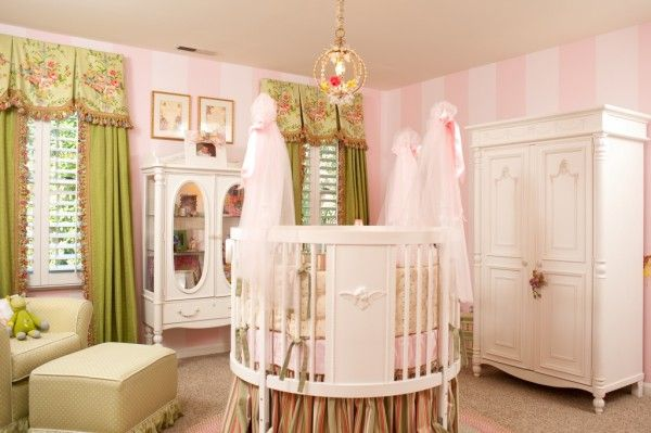 Fairy themed baby nursery with round crib