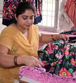 Meenu efficiently trimming and checking our Carolina Party Dresses!  This pretty dress is an all time best seller and can be found at http://eternalcreation.com/sale-girls-dresses-1-4-years/carolina-party-dress-gdb191.html