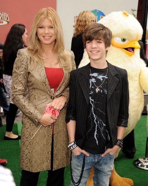 Actors Donna D'errico and Brandon Tyler Russell arrive at the premiere of Universal Pictures and Illumination Entertainment's 'HOP' at CityWalk on...