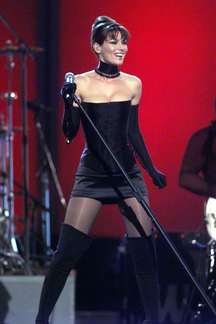 Shania Twain wearing Marc Bouwer performs at grammmys