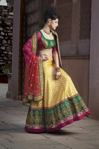 Don't you wanna slip into this Banarasi weaved ghagra with contrast border embellished with zardosi and sequin work, along with shaded net dupatta and contrast blouse?   Priced at $1,419.
