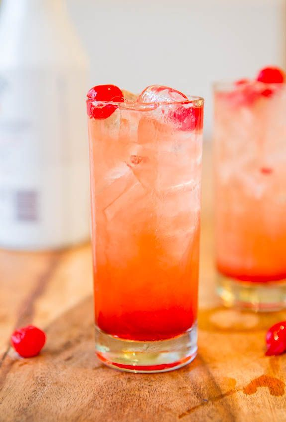 Malibu Sunset*****3 to 4 ounces pineapple-orange juice*** 2 ounces Malibu Coconut Rum*** grenadine, drizzled*** marashino cherries, for garnish