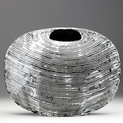 These elegant black and white slab-built vessels are by British artistJames Tower (1919 - 1988).