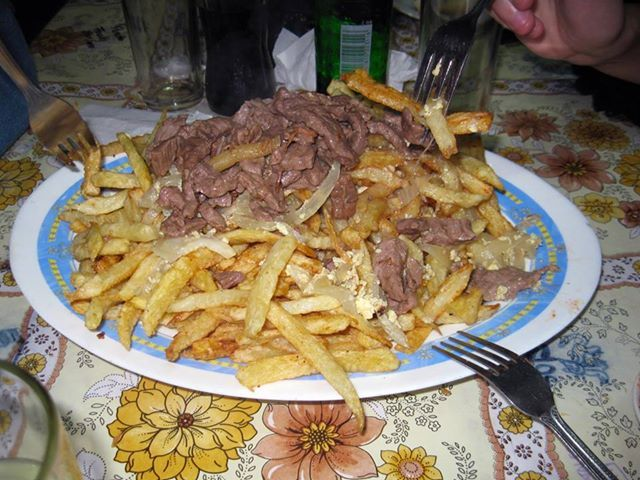"What does ""Chorillana"" mean: A typical Chilean dish of french fries, beef, pork, sausage (or a mix of more than one) with scramblend eggs and fried onions.  www.natalislang.com https://www.facebook.com/spanish.courses.natalislang"