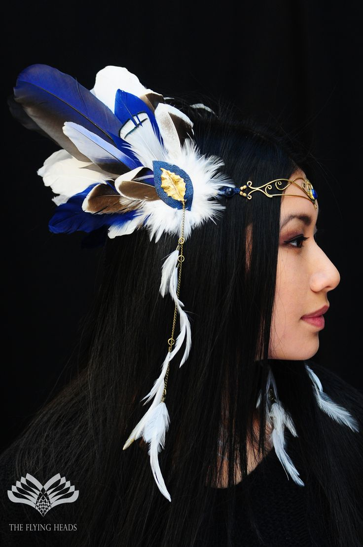 *** The Flying Heads Fairytale Feather Tiara *** While wearing this angelic headpiece it feels like flying among the clouds. The forehead-part is a beautiful brass tiara with a lapis lazuli stone in it's middle. The identical side-decorations are made of white and blue goose and rooster feathers, natural blue parrot feathers and we added a pretty brass-leaf on each side, at the very center, to compliment it.