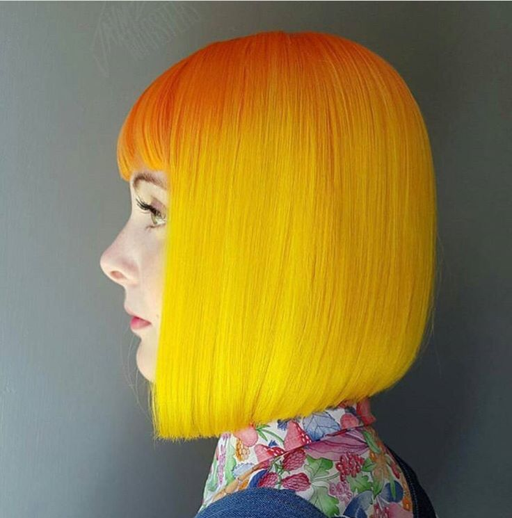 Conventional meets unconventional with this classic bob in orange to golden yell…