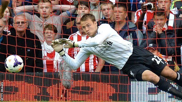Simon Mignolet saves the penalty.