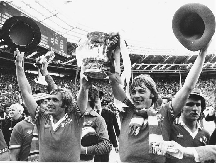 Jimmy Greenhoff and his brother Brian holding the FA Cup after they had both played in the Manchester United team beating Liverpool in the final