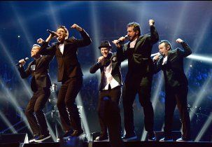 The *NSYNC boys say 'Bye, Bye, Bye' (or should that be Hi, Hi, Hi?) at the 2013 MTV Video Music Awards in Brooklyn, New York.