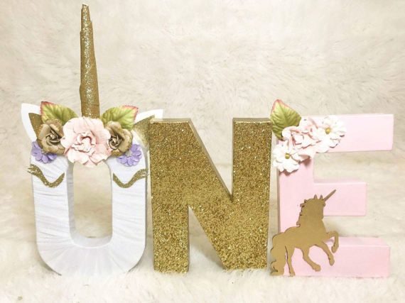 A magical prop for a magical party! Add an itty bit of fun to your itty bittys first birthday or photo shoot! our custom letter/number sets are the perfect photo props and size! This listing features our Unicorn birthday prop! ***These letters are just like every unicorn that is graced with the constantly shifting shimmering sheen of magic; there may be some variations in the colors and placement of floral embellishments*** -lettermeasures 8 inches -glitter is sealed for minimal shedd...