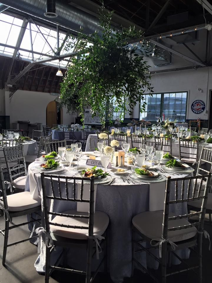 Beautiful wedding set up by Twigs & Branches at the Packard Proving Grounds Historic Site in Shelby Twp, MI Fern greenery wedding decor. Chivari chairs. Metro Detroit Wedding reception