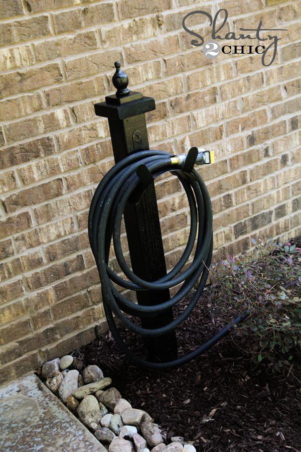 Best 25 hose holder ideas on pinterest garden hose for Garden hose idea