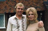 English footballer Bobby Moore of West Ham United at home with his wife Tina circa 1970