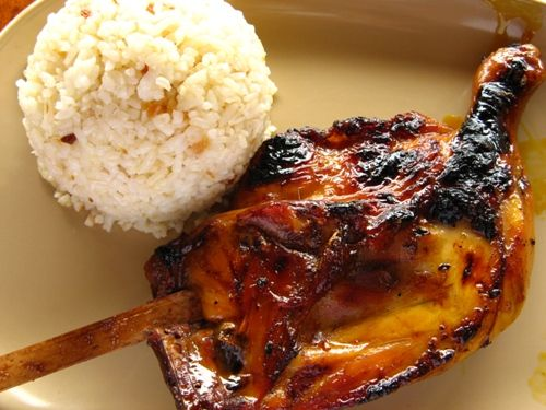 INASAL What it is: Skewered, grilled chicken marinated in lime, peppers, vinegar, and tropical seeds What's the deal: Another popular street food and cookout staple, Inasal originated in the west coast city of Bacolod, also known as the City of Smiles -- smiles that are filled with chunks of grilled chicken that're first marinated, and then coal-roasted while being basted with that vinegar-y juice.  http://panlasangpinoy.com/2010/07/12/grilled-chicken-inasal-recipe/