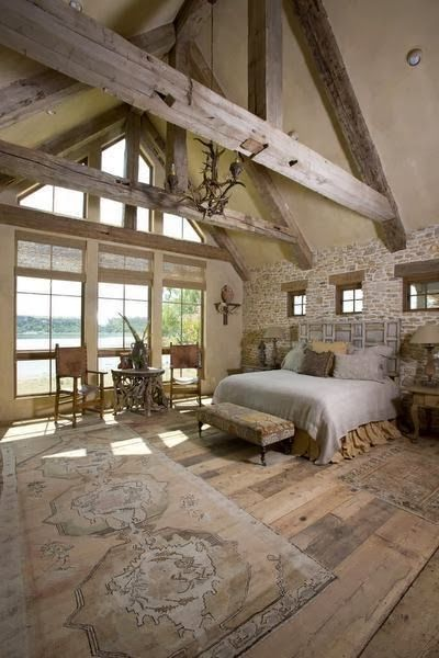 """A Rustic """"Upscale French Barn"""" House in Texas on Possum Lake in Texas. Photos by Ross Hailey. For more photos and information please visit: Indulge - French Barn Style Home - Beautiful Master Bedroom with Lake View!"""