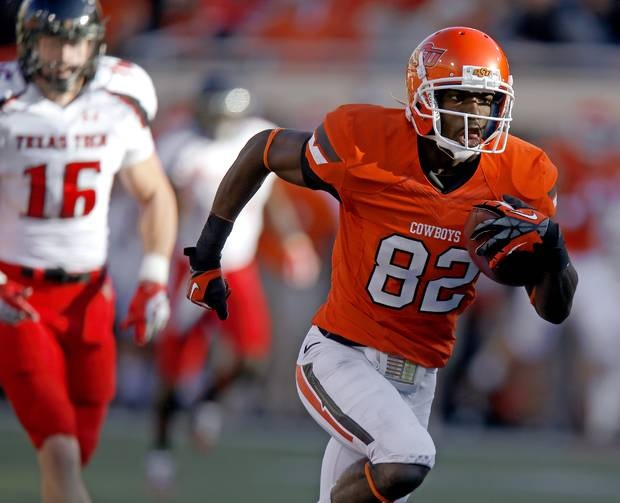 Oklahoma State's Isaiah Anderson (82) scores a touchdown during a college football game between Oklahoma State University (OSU) and Texas Tech University (TTU) at Boone Pickens Stadium in Stillwater, Okla., Saturday, Nov. 17, 2012.  Photo by Bryan Terry, The Oklahoman