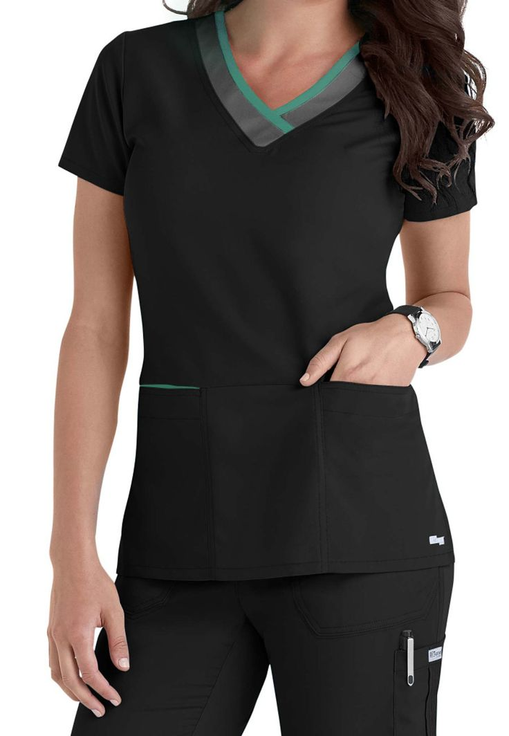 LEADER OF THE PACKGrey's Anatomy shows off subtle style with contrasting colors on the neckline and pockets for this terrific scrub top.  This top gives you a perfectly professional look with that perfect touch of detail. Over a dozen color options let you stand out from the crowd, and you can tuck your cell phone away in a special pocket-in-a-pocket.   Grey's Anatomy Color Block 3-pocket V-neck Scrub Tops  V-neck  Two patch pockets with bonus cell phone pocket  Modern Fit  Back darts...