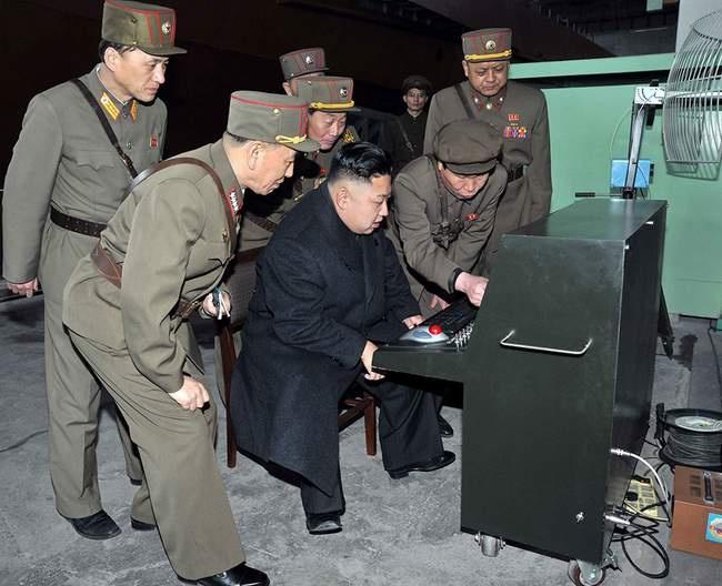 Kim Jong Un looking at a military computer.