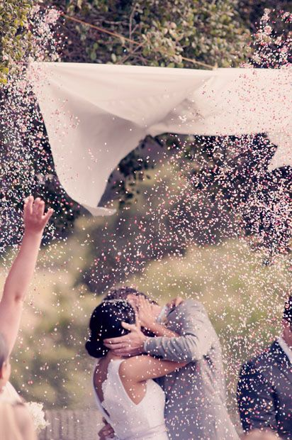 Have a canopy over the bride and groom and at the first kiss pull a cord to rain down confetti!